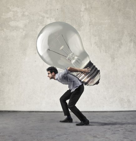 Photo for Man carrying a great new innovation - Royalty Free Image