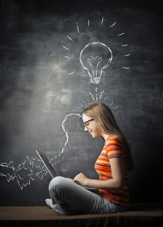 Photo for A girl put her ideas on the laptop - Royalty Free Image
