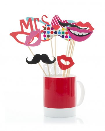 Photo for Photo Booth Props in a Red Mug on a White Background - Royalty Free Image