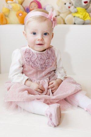 Toddler girl wearing pink dress