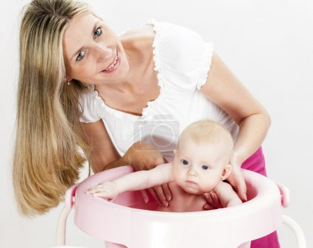 Photo for Portrait of mother with her baby during bathing - Royalty Free Image