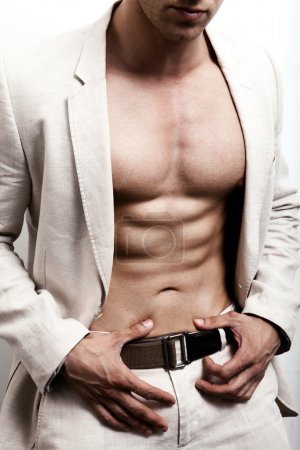 Elegant man with sexy abs posing fashion