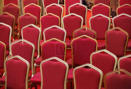 Rows of empty red seats in theater hall