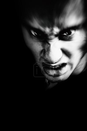 Photo for Evil face of scary angry man in the dark - Royalty Free Image