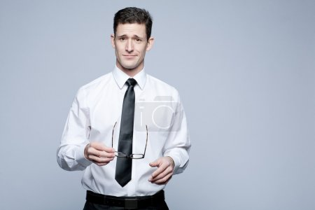Young handsome businessman in white shirt.