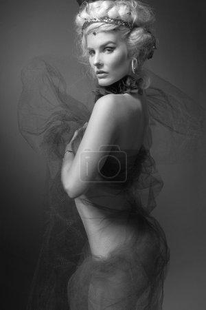 Young fashion model wearing designer dress.