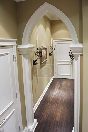 Home corridor with decorative metal details.