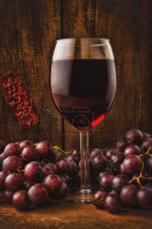 Photo for Vintage look of a glass of wine with grapes - Royalty Free Image