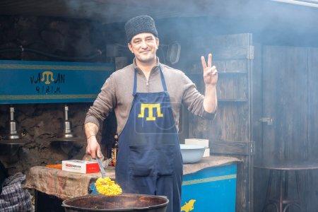 LVIV, UKRAINE - February 22, 2015 Crimean Tatar runs street food business