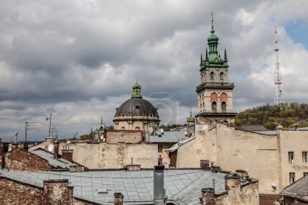 High tower among old roofs, Lviv