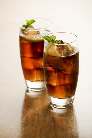 Soda or cola with lemon