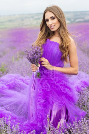 Woman in purple fashion dress at lavender fields