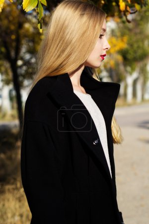 Pretty girl is wearing winter black coat