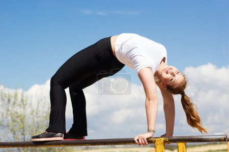 Gymnast girl doing stretching exercise