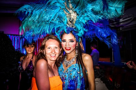 KOH SAMUI, THAILAND 2013, 2 APRIL Transvestites in Chaweng nightclub take a picture with tourists