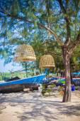Boat on island in Thailand near tree