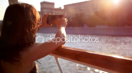 Young beautiful woman with sunglasses taking picture With smartphone in sea voyage on cruise ship. HD. 1920x1080
