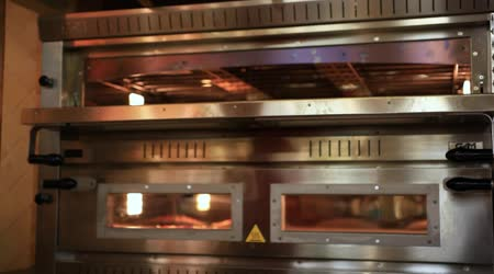 Chef puts dough in the oven for pizzas and close  Oven, traditional cooking. Close up. HD. 1920x1080