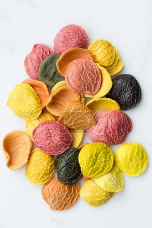 Photo for Colorful orecchiette pasta uncooked - Royalty Free Image