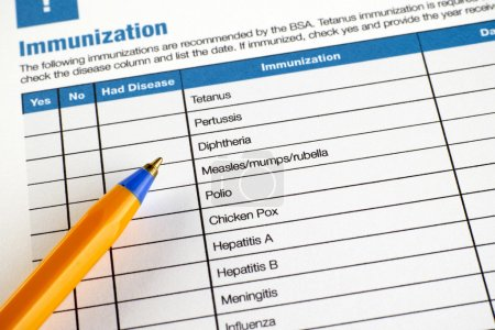 Immunization application form with ballpoint pen....