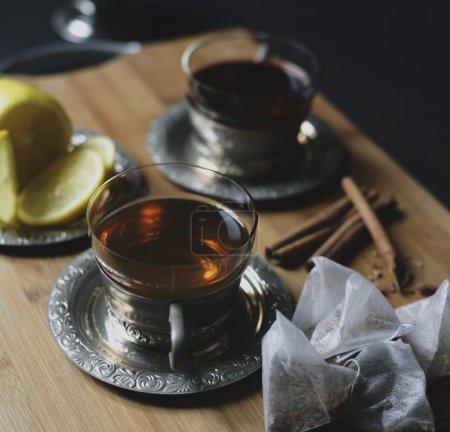 Teacups,cinnamon,spices,ingredients and lemon