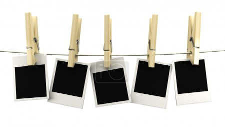 Retro photo frame hanging on a rope on wooden clothespins