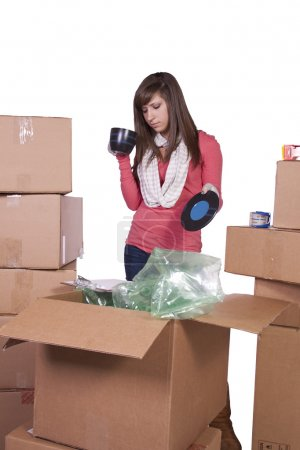 Photo for Young girl packing up and moving - white background - Royalty Free Image