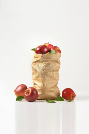 Photo for Paper bag of ripe apples on white background - Royalty Free Image