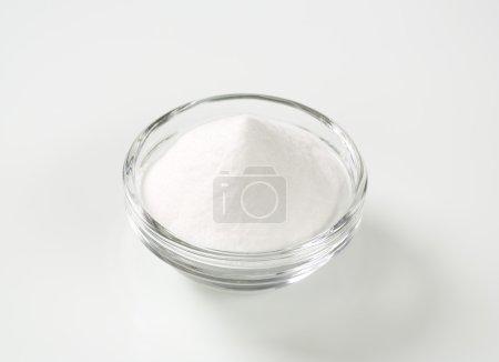 Photo for Bowl of sodium bicarbonate on white background - Royalty Free Image