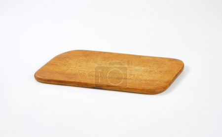 Photo for Old thin wooden cutting board - Royalty Free Image