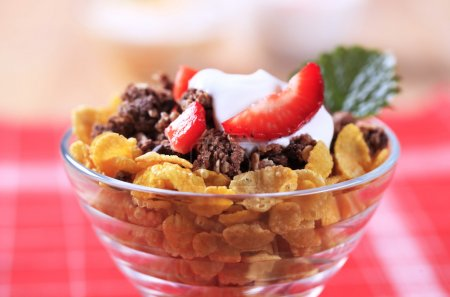 Photo for Cornflakes and chocolate granola with sour cream - Royalty Free Image