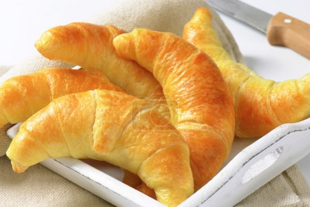 Photo for Fresh butter crescent rolls (croissants) on white wooden tray - Royalty Free Image