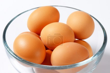 Photo for Brown organic eggs in a glass bowl - Royalty Free Image