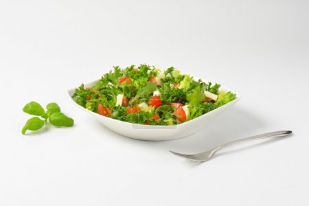 Photo for Bowl of fresh vegetable salad with feta cheese - Royalty Free Image