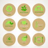 Vektoru vegetarián a vegetariánské jídlo emblémy