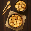Overhead shot of two rustic bowls of bread pudding...