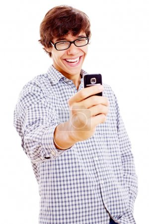 Smiling guy making picture by phone