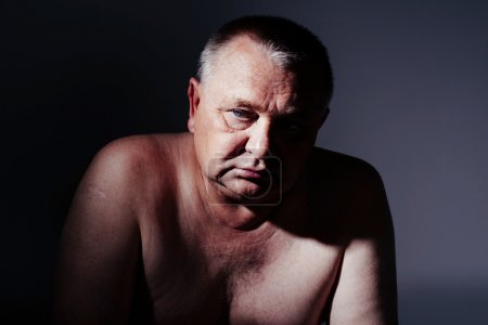 Photo for Dramatic close-up portrait of pensive middle aged man looking aside - Royalty Free Image