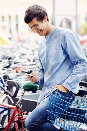 Man with smartphone and bicycle