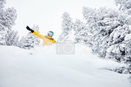 Man in backcountry snowboarding