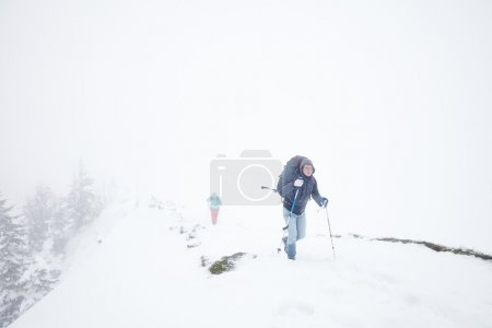 Extreme winter hiking in Alps