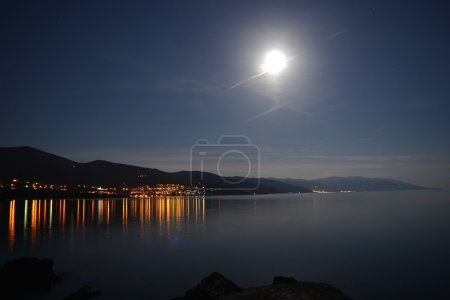 Photo for Bright moon illuminate of sea shore. Night  on resort - Royalty Free Image