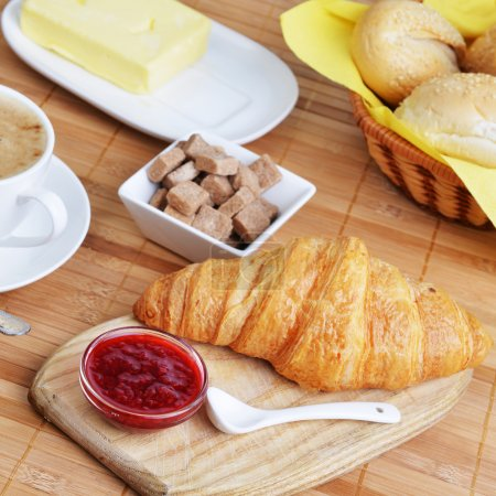 Photo for Croissant with jam and cup of coffee for breakfast - Royalty Free Image