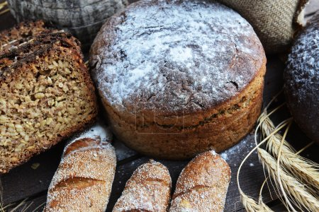Fresh bread, buns and wheat