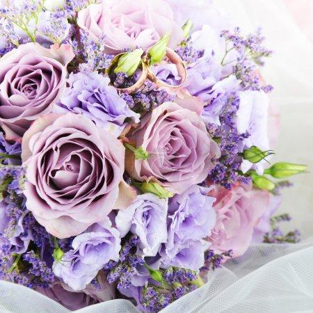 Purple flowers with wedding  rings