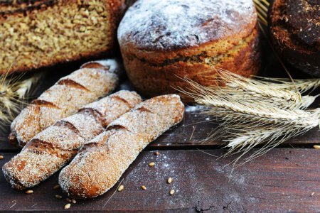 Fresh bread with buns and wheat