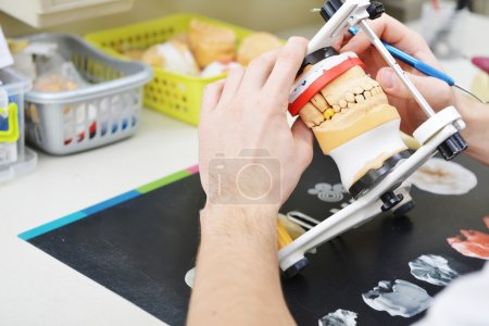 Dental technician working on false teeth