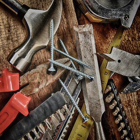 Photo for Set of different tools on wooden background - Royalty Free Image