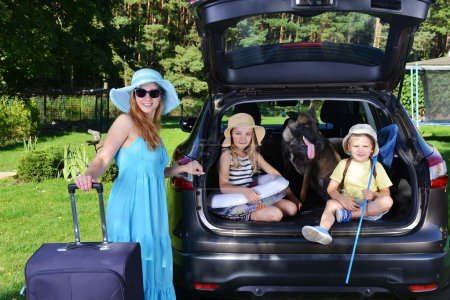 children and dog in car