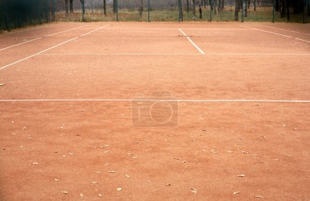 Photo for End of summer sport season. Empty tennis court in autumn - Royalty Free Image